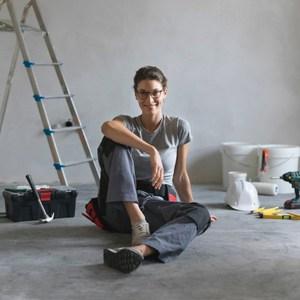 happy woman in freshly painted room